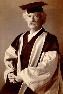 Mark Twain in his gown (scarlet with grey sleeves and facings) for his D.Litt. degree, awarded to him by Oxford University