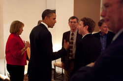 Zuckerberg listening to President Barack Obama before a private meeting where Obama dined with technology business leaders in Woodside, California, February 17, 2011. Also seen in the picture are Carol Bartz of Yahoo!, Art Levinson of Genentech, Steve Westly of The Westly Group, and Eric Schmidt of Google.