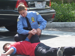 An LAPD cadet conducting a hand cuffing drill