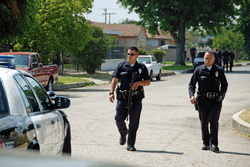 An LAPD policeman armed with an                                 AR-15                                in 2011.