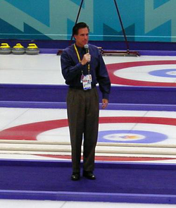 Romney, as president and CEO of the                                 Salt Lake Organizing Committee                                for the                                 2002 Winter Olympics                                , speaking before a                                 curling                                match