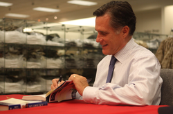 Romney signing copies of his new book                                                   No Apology: The Case for American Greatness                                                 for service members at                                 Marine Corps Air Station Miramar                                in March 2010