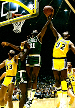 Johnson (right) battles                                 Boston                                's                                 Cedric Maxwell                                in                                 1985 NBA Finals