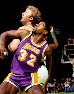 Johnson battling with                                 Bird                                for rebounding position in Game 2 of the 1985 NBA Finals at                                 Boston Garden                                .