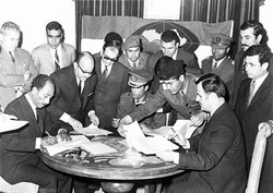 In 1971, Egypt's Anwar Sadat, Libya's Gaddafi and Syria's Hafez al-Assad signed an agreement to form a federal Union of Arab Republics. The agreement never materialized into a federal union between the three Arab states.