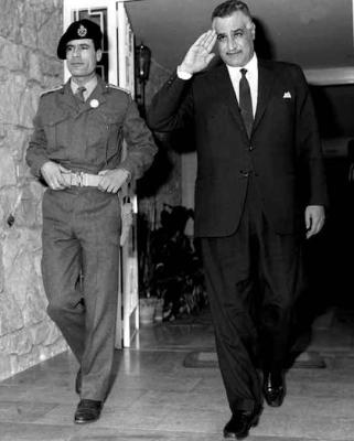 "Gaddafi (left) with Egyptian President Nasser in 1969. Nasser privately thought Gaddafi ""a nice boy, but terribly naive""."