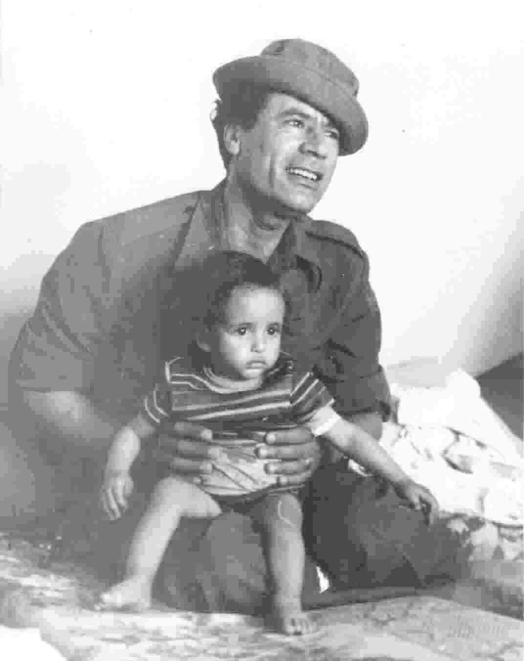 Gaddafi in 1976 with a child on his lap