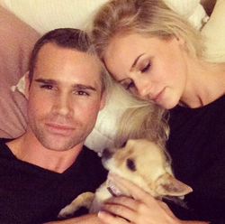 Anna Nyström taking selfie with her boyfriend and dog.