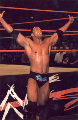 The Rock taunts Rob Van Dam at ringside