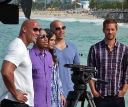 Fast Five cast members promoting the film in Rio de Janeiro; from left: Johnson, Ludacris, Jordana Brewster, Vin Diesel, and Paul Walker