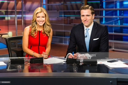 Photo of Sara Eisen and her co-anchor Wilfred Frost