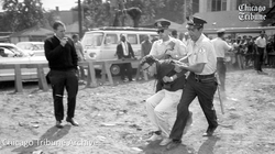 Photo of                               Bernie Sanders                              being detained and arrested when he was a young College Student.
