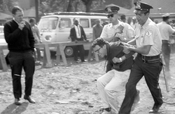 Sanders being arrested at a 1963 anti-segregation protest in Chicago. He was later found guilty of resisting arrest and charged $25.                                                   [33]