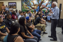 Sanders speaks with young adults in                                 Des Moines, Iowa                                , September 2015.