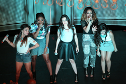 Fifth Harmony performing on their Harmonize America Mall Tour, August 2013.