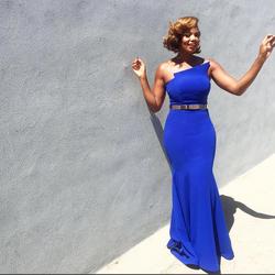 Tai in a blue dress.[3]