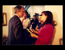 Pilar interviewing George W. Bush. [5]
