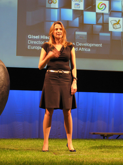Gisel Hiscock presenting at a tech conference.