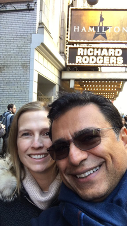 Gisel and       Omid Kordestani      ​ take a selfie outside of the musical       Hamilton