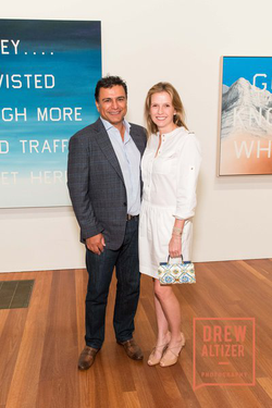 Gisel and       Omid Kordestani      ​ at a photography show