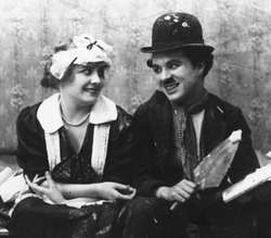 Chaplin and Edna Purviance, his regular leading lady, in Work (1915)