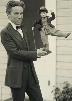 By 1916, Chaplin was a global phenomenon. Here he shows off some of his merchandise, c. 1918.