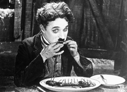 The Tramp resorts to eating his boot in a famous scene from The Gold Rush (1925).