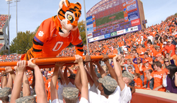 Clemson's Tiger mascot performing push-ups after a touchdown.