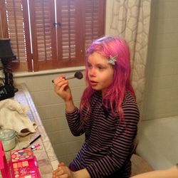 Avery doing her makeup