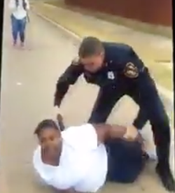 Photo of the officer assaulting Jackie Craig