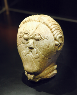 Stone head of a hero (cc. 450-50 B.C.) wearing a torc, example of Iron Age Celtic art.