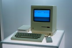 The first                                 Macintosh                                , released in 1984, was the first mass-market personal computer featuring an integral graphical user interface and mouse.