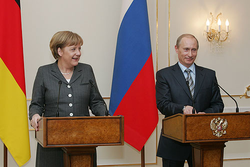 Merkel and                                 Vladimir Putin                                ,                                 President of Russia                                , holding a joint press conference, 8 March 2008