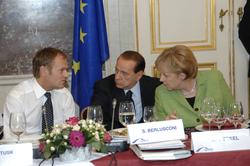 Merkel, Polish Prime Minister                                 Donald Tusk                                and Italian PM                                 Silvio Berlusconi                                , 2008