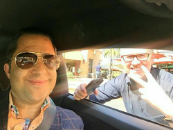 Antik Bose with Real estate coach Tom Ferry while driving his Lamborghini Huracan