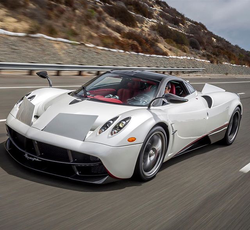 Antik Bose driving his White carbon fiber Pagani Huayra at Newport Coast Drive.