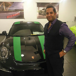 Antik Bose buying his 2016 Porsche 911R from Porsche Downtown LA