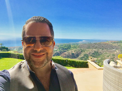 Antik Bose at his Crystal cove Newport Coast house enjoying a Panoramic view.