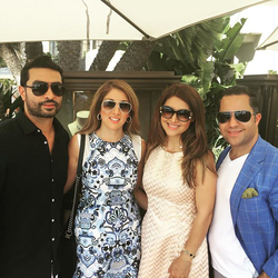 Antik Bose enjoying lunch with friends while hosting a Private exhibition of his Super Cars at Pelican Hill.