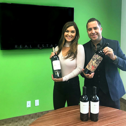 Antik Bose with the Orin Swift and Sauvignon Blanc wine bottles bought from Make A Wish Orange county & Inland Empires' Evening of Wishes Auction 2017