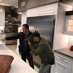 Antik Bose assisting a photographer in a photo shoot of his mansion in Corona del Mar, CA