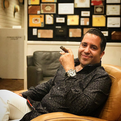 Antik Bose enjoying a cigar at the Grand Havana Room, Beverly Hills.