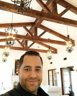 Antik Bose at his Corona del Mar Mansion showing the renovated roof design