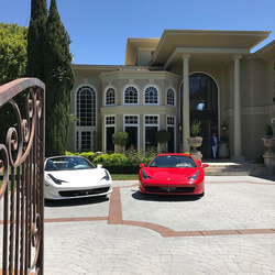 The entrance view of Antik Bose's house in Sammamish, WA with his Ferraris