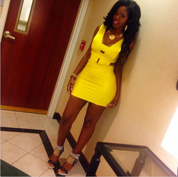 Juju in a yellow dress