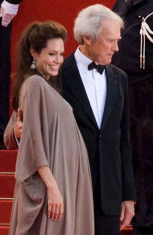 A pregnant Jolie with director Clint Eastwood at the Cannes premiere of Changeling in May 2008