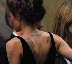 Jolie at the New York premiere of A Mighty Heart in June 2007; several of her tattoos are visible