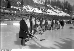 An                                 ice hockey                                game during the                                 1928 Winter Olympics                                at                                 St. Moritz                                .