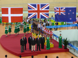 A medal ceremony with the                                 Danish flag                                , the                                 Union Jack                                of the                                 United Kingdom                                , and the                                 New Zealand flag                                from left to right during the 2008 Summer Olympics.
