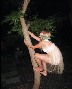 Climbing a tree with her bird.